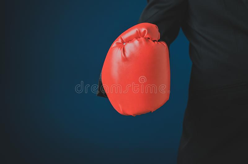 Businessman hand in red boxing glove stock photo