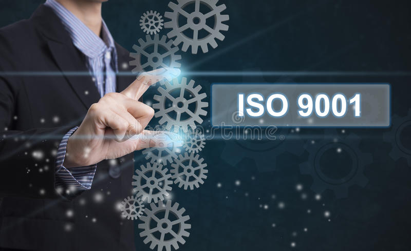 Businessman hand select wording iso 9001. stock photo