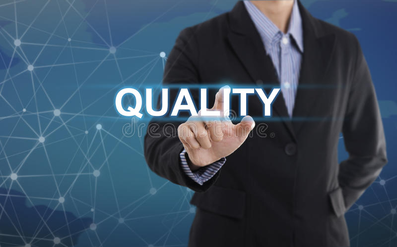 Businessman hand select wording quality. stock photo
