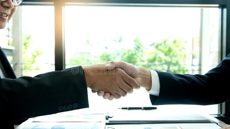 businessman hand shake with another business man stock photo