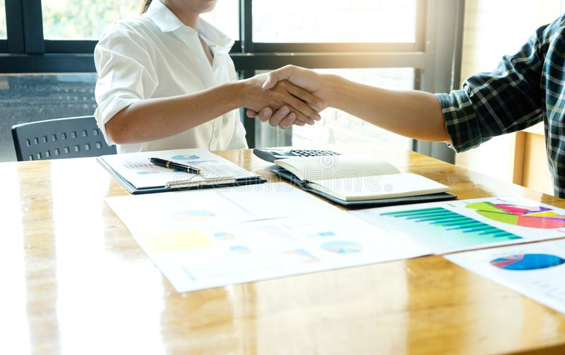 businessman hand shake with another business man woman stock photo