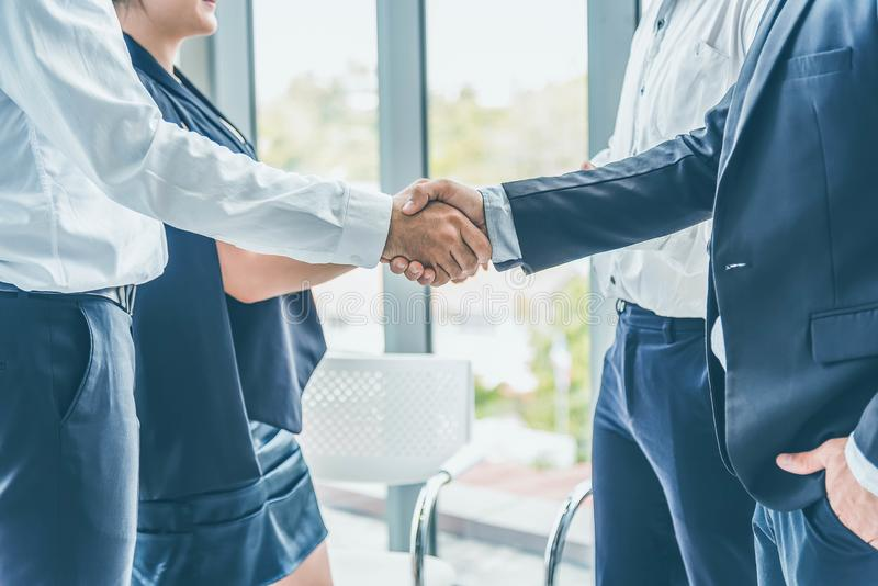 Businessman hand shake after the new project meeting. Business agreement concept stock images