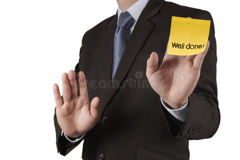 Businessman hand show well done words on sticky note with white. Background as concept stock photos