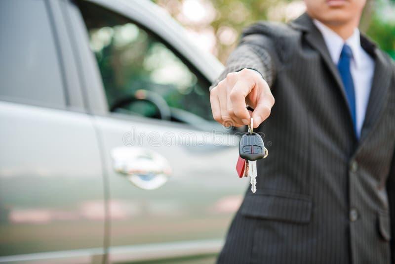 Businessman hand showing car key. Business concept stock photos