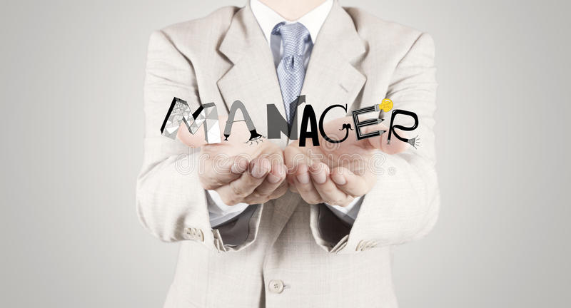 Businessman hand showing design graphic word MANAGER. As concept royalty free stock photos