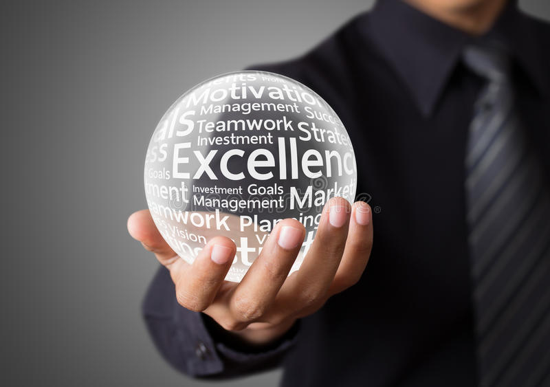 Businessman hand showing excellence word. In crystal ball royalty free stock image