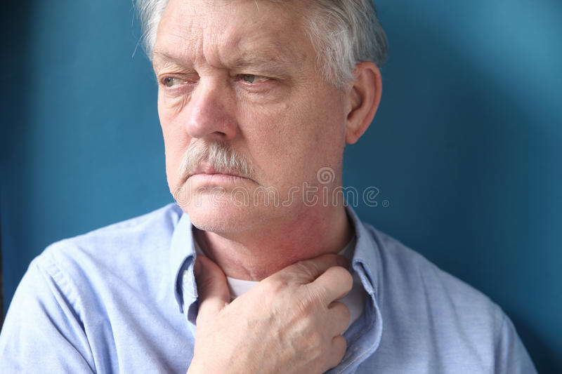 Businessman with hand at throat royalty free stock photos