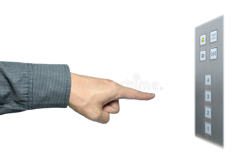 Businessman hand to press button on lift stock photo