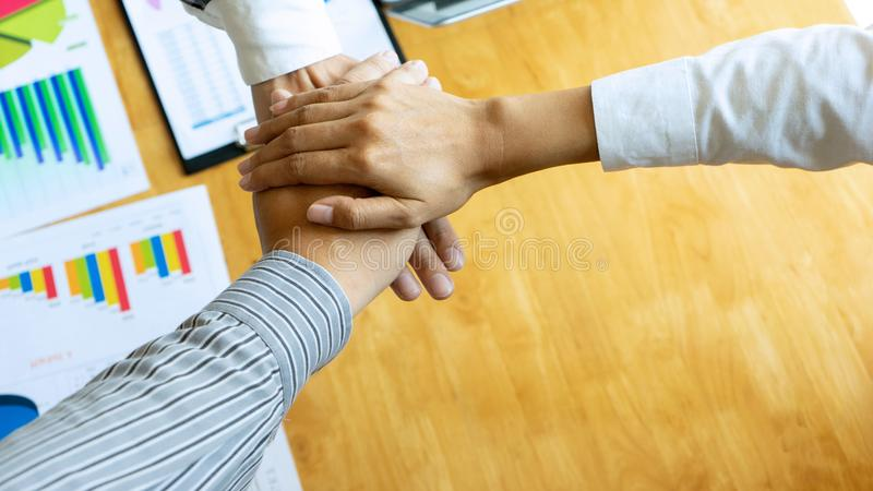 businessman hand together with another business stock image