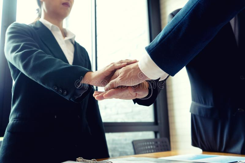Businessman hand together Handshake for business royalty free stock photo