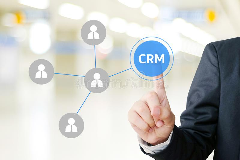 Businessman hand touch CRM, Customer Relationship Management, icon over blur background, success in business concept royalty free stock photography