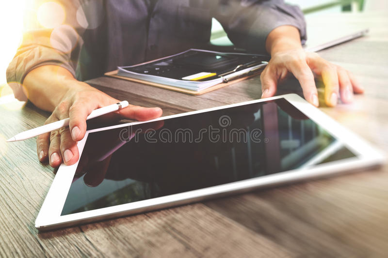 Businessman hand touching digital tablet.Photo finance manager w royalty free stock photos