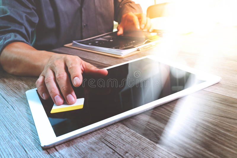 Businessman hand touching digital tablet.Photo finance manager w royalty free stock images