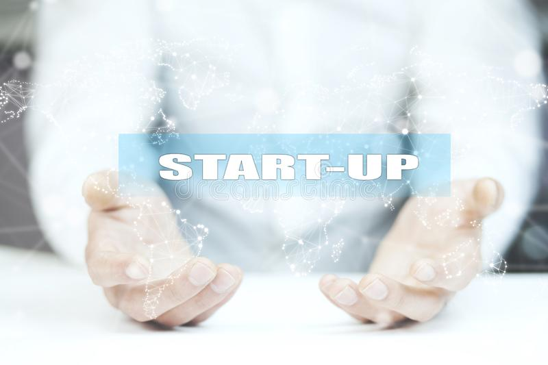 Businessman hand touching START UP button on virtual screen royalty free stock photos