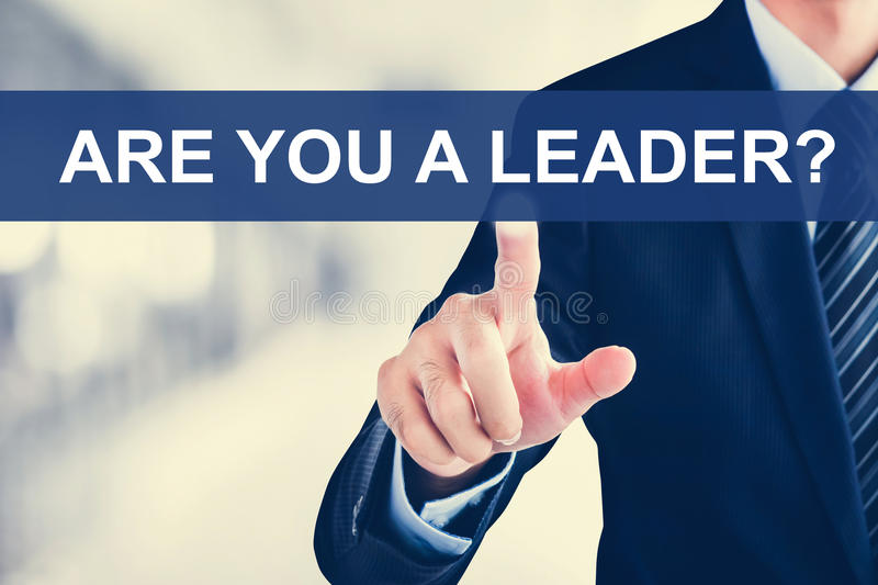 Businessman hand touching ARE YOU A LEADER? message on virtual s royalty free stock images