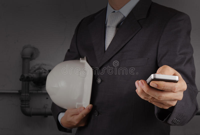 Businessman Hand Use Smart Phone Computer With Pipe Factory Stock Images