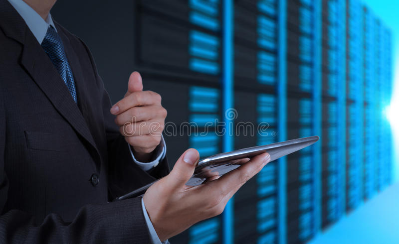 Download Businessman Hand Using Tablet Computer And Server Room Stock Photo - Image: 30574412