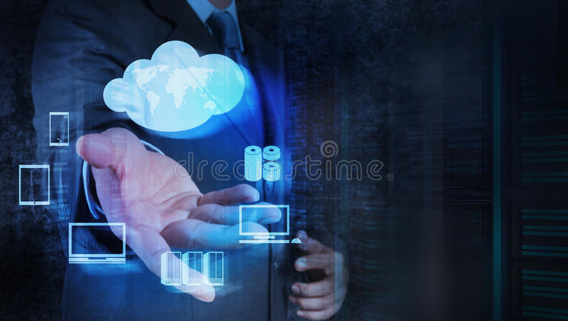Businessman hand working with a Cloud Computing. Diagram on the new computer interface as concept royalty free stock photo