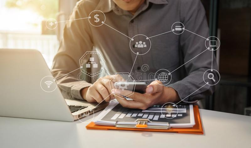 Businessman hand working digital marketing media in virtual screen with mobile phone and modern computer. royalty free stock images