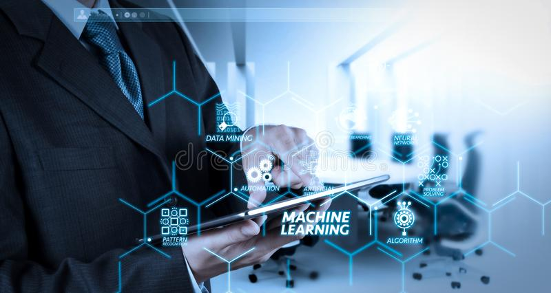 Businessman hand working with a digital tablet. Machine learning technology diagram with artificial intelligence (AI),neural network,automation,data mining in VR royalty free stock image