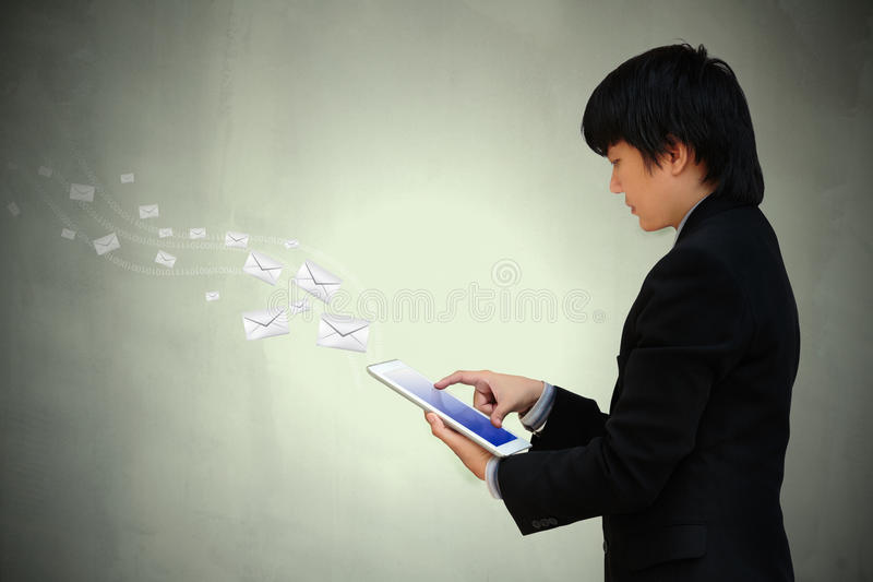 Businessman hand working with tablet. Computer sending email royalty free stock image