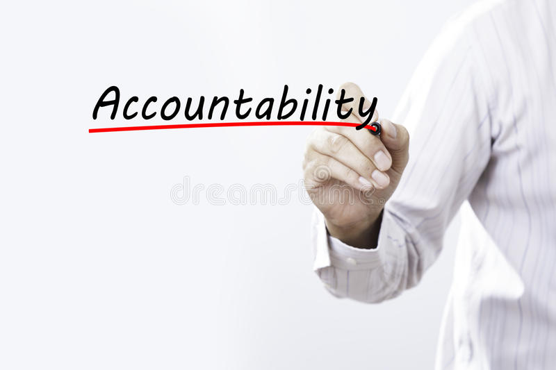Businessman hand writing Accountability with red marker on trans. Parent wipe board, business concept royalty free stock photography