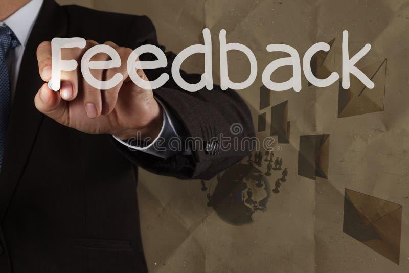 Businessman hand writing Feedback stock image
