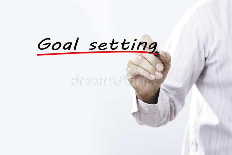 Businessman hand writing goal setting with marker, Business concep. T royalty free stock images