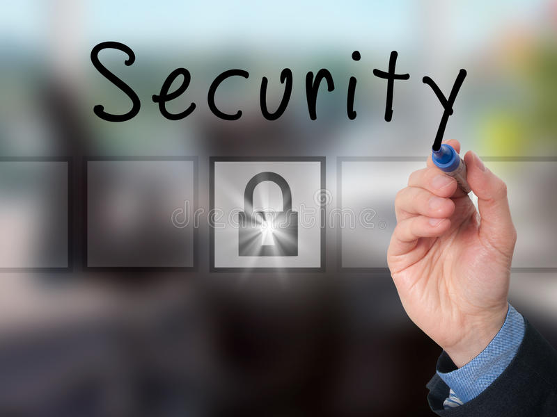 Businessman hand writing Security on transparent board royalty free stock image