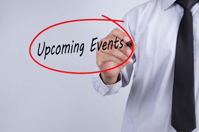 Businessman Hand Writing Upcoming Events with a marker over tran royalty free stock photo