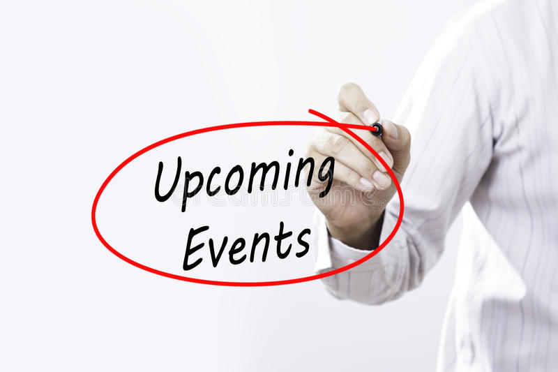 Businessman Hand Writing Upcoming Events with a marker over tran stock image
