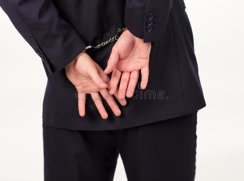 Businessman with handcuffs stock image