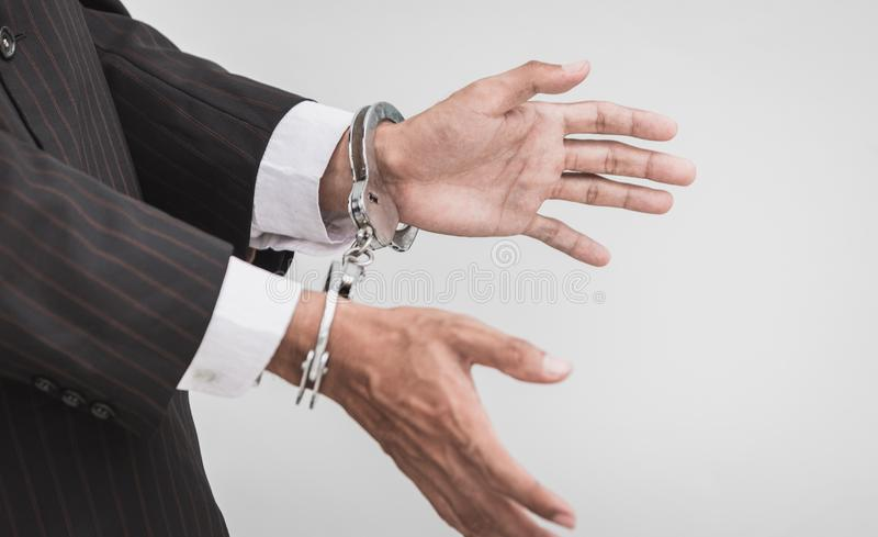 Businessman with handcuffs royalty free stock photos