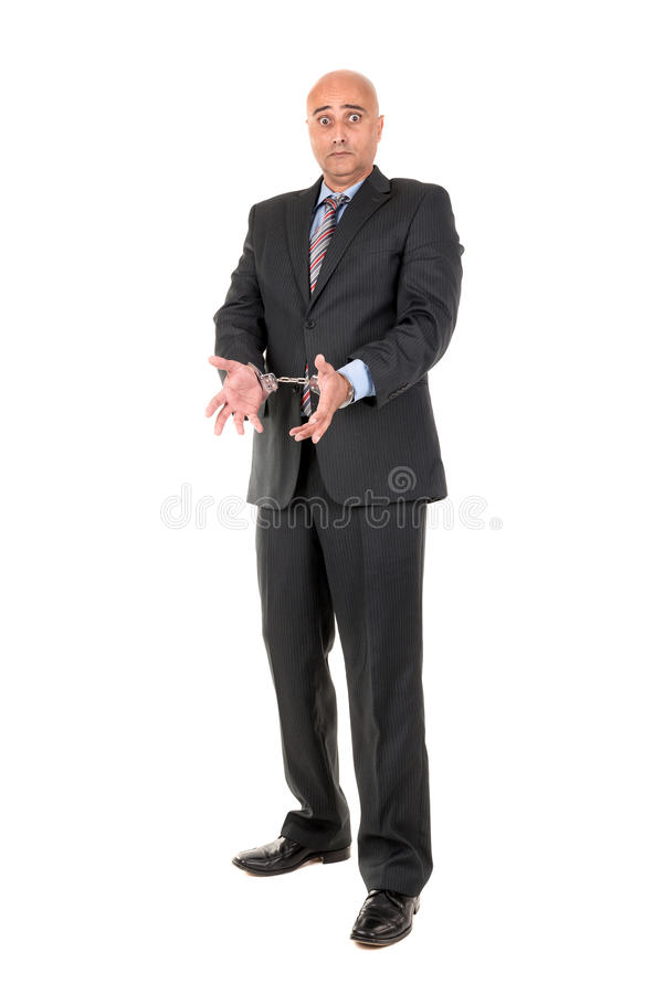 Businessman in handcuffs. Isolated in white background royalty free stock images
