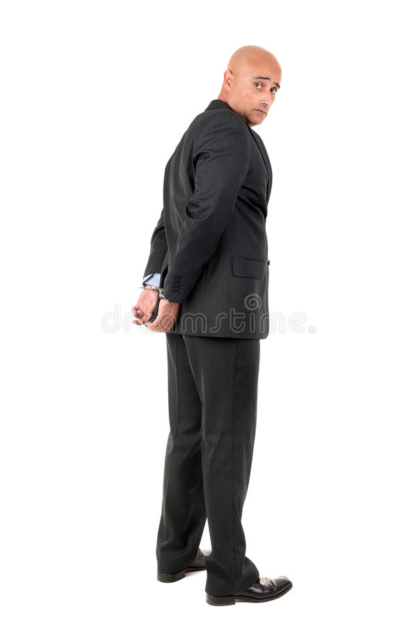 Businessman in handcuffs. Isolated in white background stock photography
