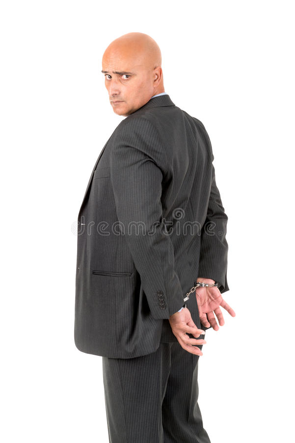 Businessman in handcuffs. Isolated in white background stock photo