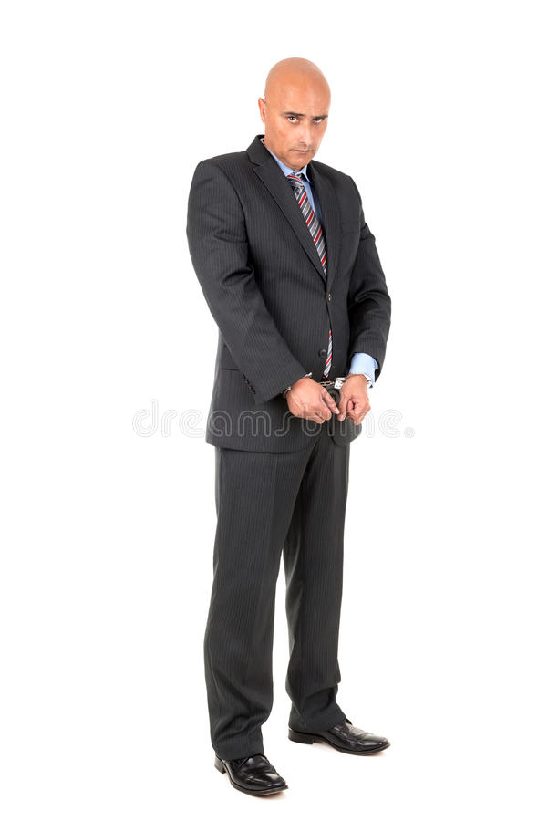 Businessman in handcuffs royalty free stock photo