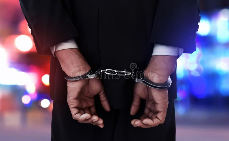 Businessman in handcuffs on the street royalty free stock images