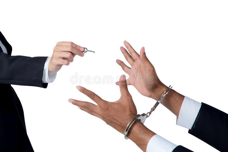 businessman in handcuffs and woman hand offering key solving business concept stock photos