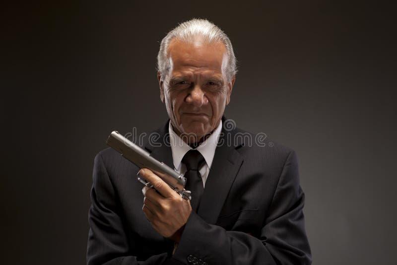 Businessman with handgun royalty free stock image