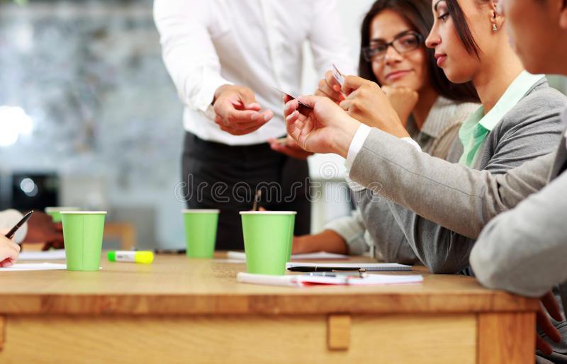 Businessman handing out a business card royalty free stock photo