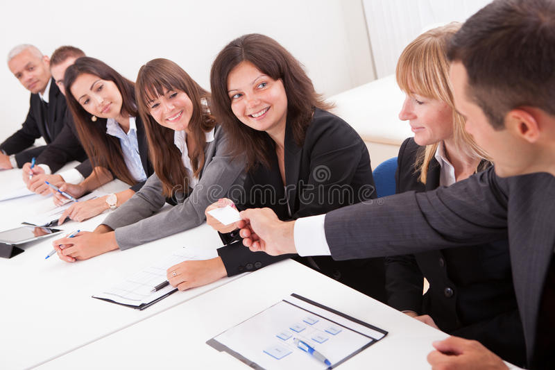 Businessman handing out a business card stock image image of download businessman handing out a business card stock image image of businesscard look colourmoves