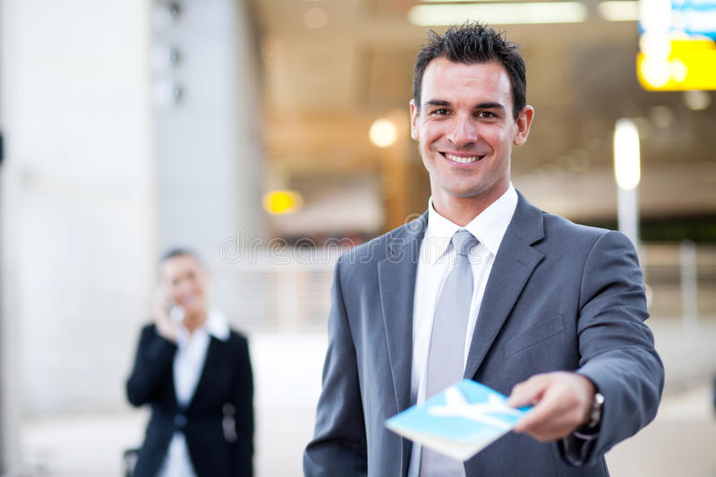 Businessman handing over air ticket royalty free stock image