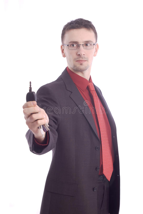 Businessman handing over the keys royalty free stock photos