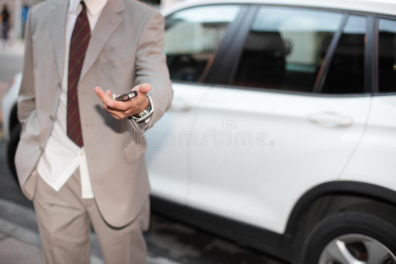 Download Businessman Handing Over The Keys Stock Photography - Image: 22733052
