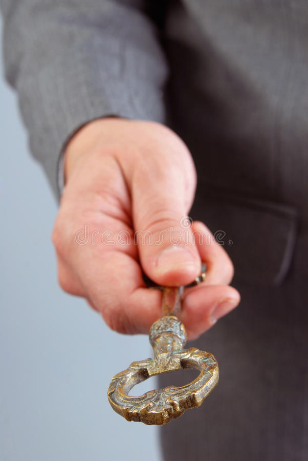 Businessman handing a success key royalty free stock image