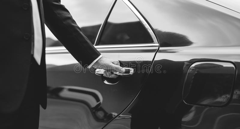 Businessman Handle Limousine Door Car. Concept stock photos