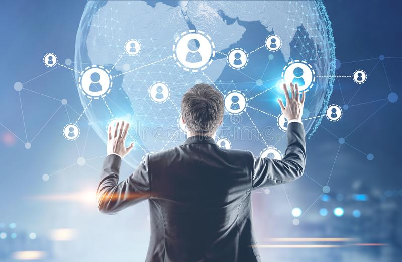 Businessman with hands in the air, network map stock photo
