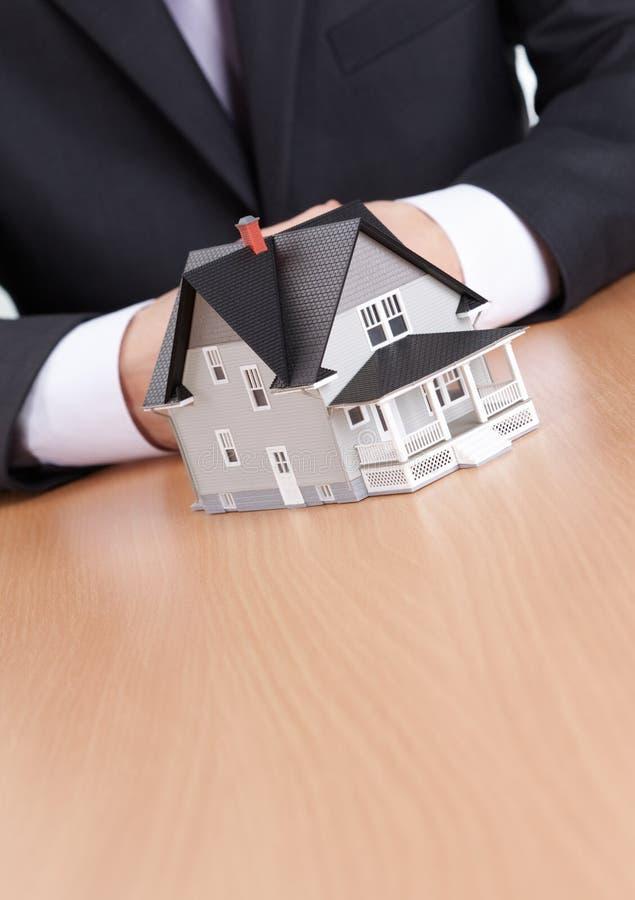 Download Businessman Hands Behind House Model Stock Image - Image: 25803669