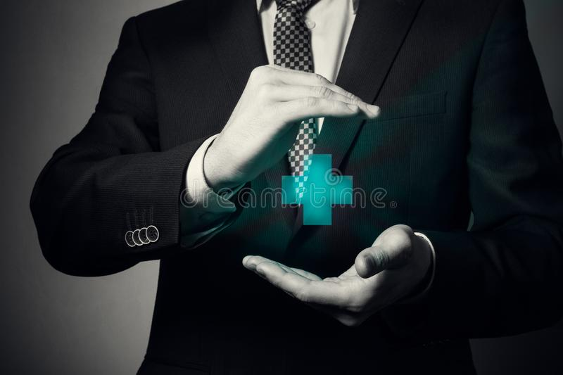 Life and health insurance. Businessman hands closeup. a man in business suit shows caring gesture. life and health insurance stock photo